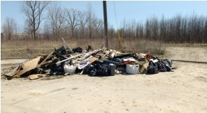 Some of the illegally dumped garbage collected included: a barbeque, bed mattress, bedsprings, butane canisters (32), carpet, cement blocks, chair, cushions, fuel tank from truck, garden hose, golf bag, lamp shade, landscaping cloth, lawn mower, paneling, patio stones, plastic jugs and pails, plywood pieces, power washer, roof shingles, sofa bed, swimming pool solar blanket and hose, televisions (2), tires (5), tonneau cover for a pickup truck, garden umbrella, vinyl house siding, pallets